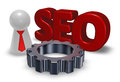 Seo tag, gear wheel and pawn with tie Royalty Free Stock Photo