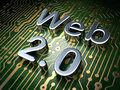 SEO web design concept: Web 2.0 on circuit board background Royalty Free Stock Photo