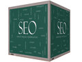 Seo word cloud concept on a d cube blackboard with great terms such as search engine optimization and more Stock Image