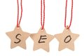Seo word spelled with paper stars are hung by ropes isolated against white background Stock Image