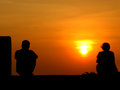Seperated couple a metaphorical image of the silhouettes of a on the backdrop of a sunset Royalty Free Stock Photos