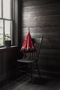 Sepia image of a red umbrella sitting on chair by the window Royalty Free Stock Photo