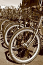 Sepia of a row of bicylce front tires Royalty Free Stock Photo