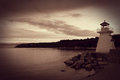 Sepia Toned Lighthouse on Coastline Royalty Free Stock Photo