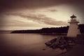 Sepia Toned Lighthouse on Coastline Royalty Free Stock Photo