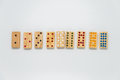 Sequence of wooden dominos on white background with selective focus Royalty Free Stock Photo