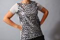 Sequins shirt beige with black spots female model in studio front view Stock Photography