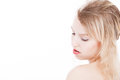 Serene blond teenager on white portrait from young woman a background with much skin visible Royalty Free Stock Images
