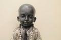 Serene boy buddha com fundo claro Fotografia de Stock Royalty Free