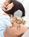 Serene family sleeping together in the morning Royalty Free Stock Photo
