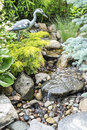 Serene garden with running stream Stock Photos