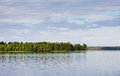 Serene landscape, a lake, forest and cloudy sky Royalty Free Stock Photo