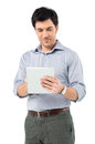Serene man with digital tablet Stockbilder