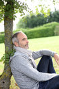 Serene man relaxing in garden senior sitting park and enjoying quietness Royalty Free Stock Image