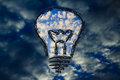 Serene sky inside lightbulb among the storm creative business vi lighbulb with in symbol of visions to overcome challenges Royalty Free Stock Image