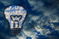 Serene sky inside lightbulb among the storm creative business vi lighbulb with in symbol of visions to overcome challenges Stock Photos