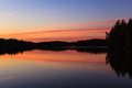 Serene view of calm lake and sunset clouds Royalty Free Stock Photo