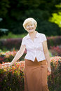 Serenity graceful good looking senior woman in casual clothes happy smiling old femele posing outdoors Stock Photography