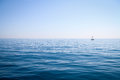 Serenity at sea a singular sailboat glides through the blue off the coast of cinque terre italy Stock Photos