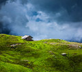Serenity serene lonely scenery background concept house in hills in mountins on alpine meadow in clouds Stock Images