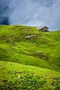 Serenity serene lonely scenery background concept house in hills in mountins on alpine meadow in clouds Stock Photo