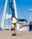 Sergey Pustovoyt. Man dancing yellow shirt blue jeans Royalty Free Stock Photo