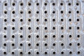 A series of hole in rows and columns on metallic surface Royalty Free Stock Photography
