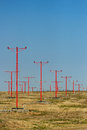 A series of landing light towers leading up to a runway Stock Photography