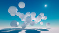 A series of large white spheres floating in the sky Stock Photos