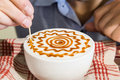 Series of person decorating coffee with art Royalty Free Stock Photo