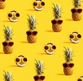 Series of pineapples and coconuts wearing sunglasses
