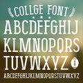 Serif font in college style medium face white print on blurred background Royalty Free Stock Image