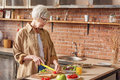 Serine old lady preparing healthy breakfast Royalty Free Stock Photo