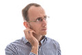 Serious and absent minded isolated businessman looking sideways with glasses bald Stock Photos