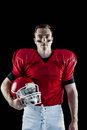 A serious american football player looking at camera Royalty Free Stock Photo