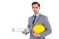 Serious architect holding plans and hard hat on white background Royalty Free Stock Photography
