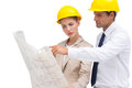Serious architects looking at construction plan with yellow helmet Royalty Free Stock Photos