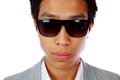 Serious asian man in sunglasses closeup portrait of a over white background Royalty Free Stock Photography
