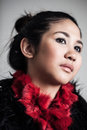 Serious asian woman portrait headshot of a beautiful young with expression wearing red scarf Royalty Free Stock Images