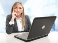 Serious attentive business woman sitting at her desk with an listener expression Stock Photo