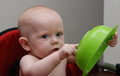 Serious Baby Points at Bowl Stock Photos