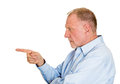 Serious blame closeup side view profile portrait senior mature man pointing with index finger at someone isolated white background Royalty Free Stock Photos