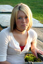 Serious Blond Woman At Outdoor Table Royalty Free Stock Photos