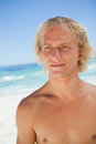 Serious blonde man looking towards the side Royalty Free Stock Photo