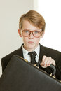 Serious boy in business suit and brief case Royalty Free Stock Photo