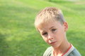 Serious boy portrait of a little with short blond hear Stock Photography
