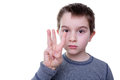Serious boy with three fingers up Royalty Free Stock Photo