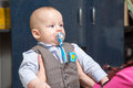 Serious boy very newborn in a suit Stock Photography
