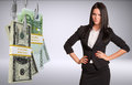 Serious business lady looking at camera and bundles of money on fish hooks on isolated grey background Royalty Free Stock Photo