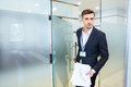 Serious business man entering the meeting room handsome holding financial report and Royalty Free Stock Photo